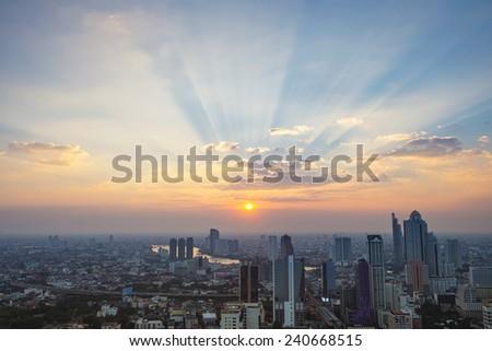 Sunset ray light and cityscape - stock photo