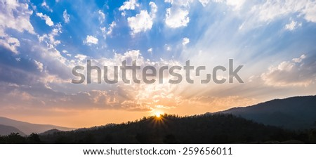 Sunset ray over mountain - stock photo
