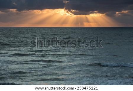 sunset rays over ocean  - stock photo