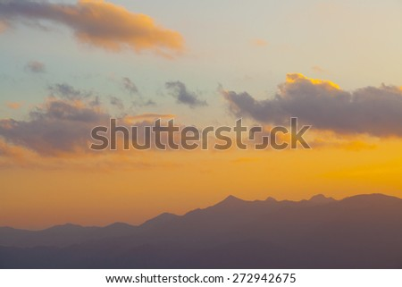 sunset, Red sky of sunset over high mountain showing twilight cloudscape