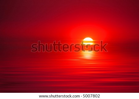 Sunset reflecting orange and red in water - stock photo