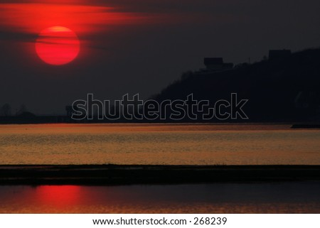 Sunset reflection in water - stock photo