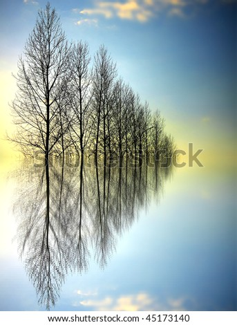 Sunset, reflection in water - stock photo