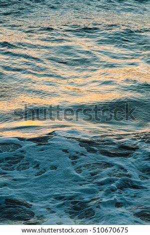 Sunset reflections on the ocean surface
