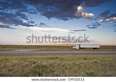Sunset Ride - blurred Semi-truck - stock photo