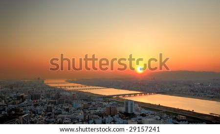 sunset river cross city - stock photo