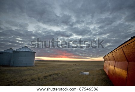 Sunset Saskatchewan Canada red sky farm granary barn - stock photo