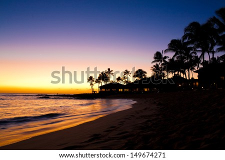 Sunset Scene at Tropical Beach Resort Silhouette - stock photo