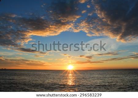 Sunset scene in the sea  - stock photo