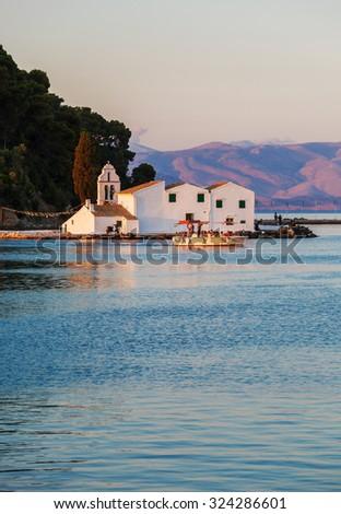 Sunset scene of Vlacherna monastery, Kanoni, Corfu, Greece - stock photo