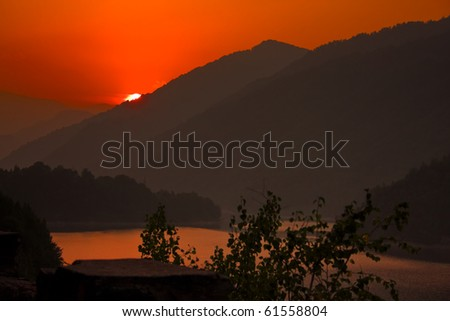 sunset scene on hills - stock photo