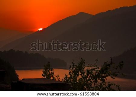 sunset scene on hills - stock photo