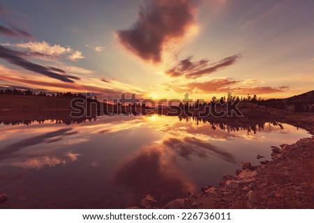 Sunset scene on lake - stock photo