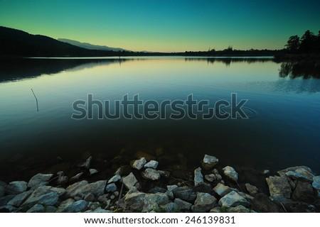Sunset scene on the lake  - stock photo
