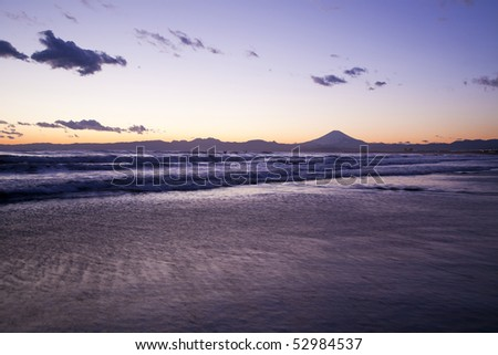 Sunset scene on the sea and Mt fuji in Japan. - stock photo