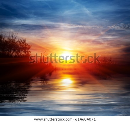 Sunset scene over lake water surface