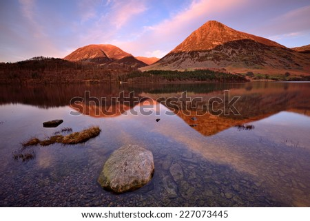 Sunset scenery with lake and mountains in the background, Lake District, England - stock photo