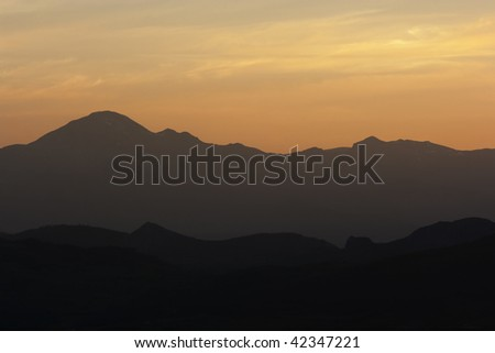 sunset scenic of a mountain range in the nature