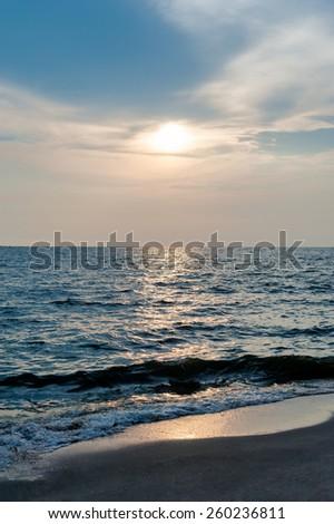 sunset/sea sand sun - stock photo