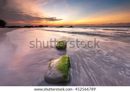 sunset seascape at kudat sabah. image may contain soft focus and blur due to slow shutter. - stock photo