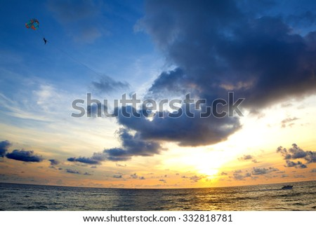 Sunset seascape.Beach and water sports. - stock photo