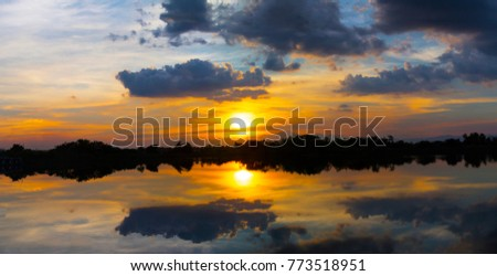 Sunset ship in sunset lake landscape
