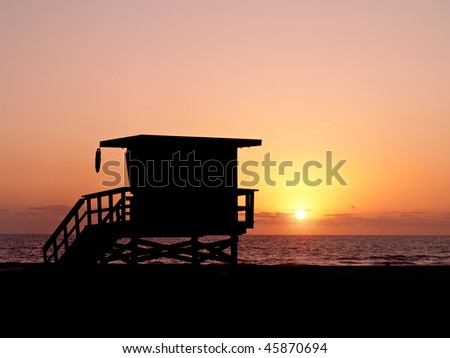 sunset shot of a baywatch lifeguard tower at malibu beach. - stock photo