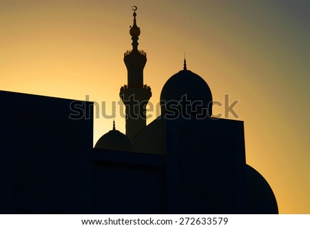 Sunset Silhouette of a mosque in Unated Arab Emirates - stock photo