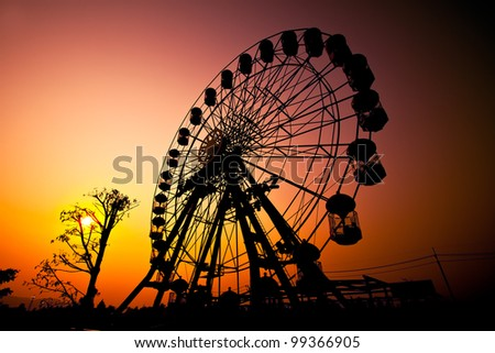 Sunset silhouette of Ferris wheel