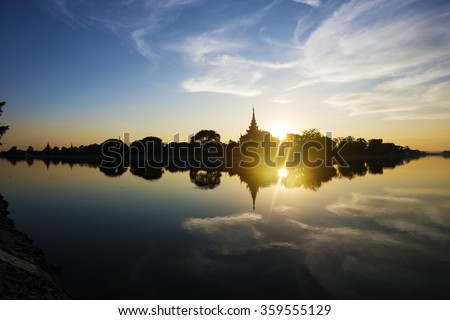 Sunset Silhouette of Mandalay Royal Palace. Myanmar (Burma)  - stock photo