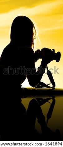 Sunset Silhouette of photographer - stock photo