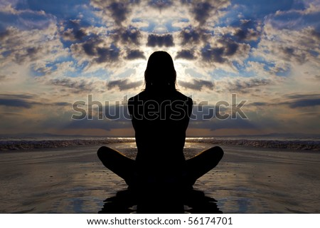 Sunset silhouette of woman doing yoga on the beach. - stock photo