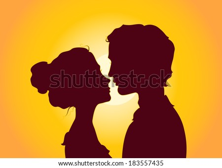 Sunset silhouettes of kissing couple - stock photo