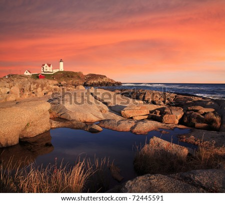Sunset Skies At The Nubble Light, A Pastoral New England Seascape, Cape Neddick, Maine - stock photo
