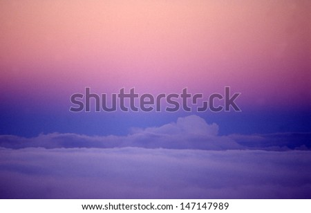 Sunset sky after a day of storms/Hawaii sky/Pastel pink and blue settle on the horizon off the Big Island in Hawaii.