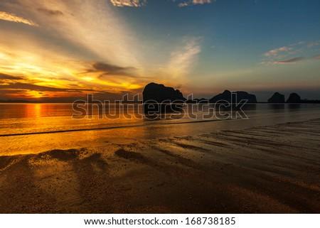 Sunset sky and beach - stock photo