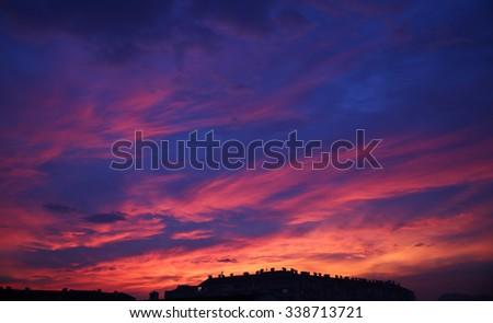 sunset sky clouds. Beautiful Cityscape Background. - stock photo
