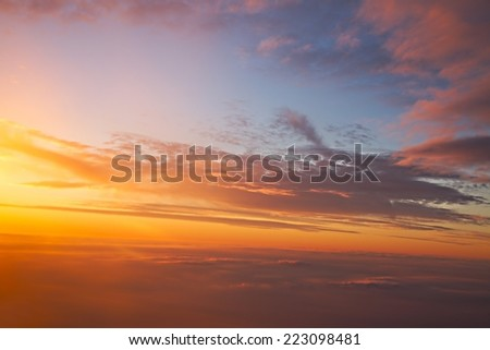 Sunset sky from a plane - stock photo