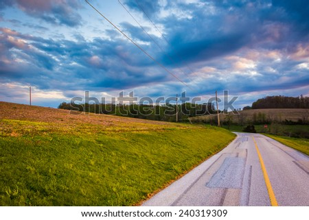 Sunset sky over a country road in rural York County, Pennsylvania. - stock photo