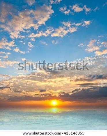 sunset sky over the sea - stock photo