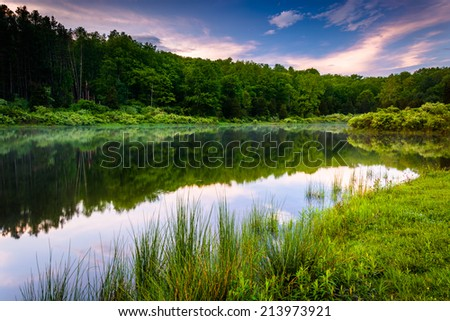 Sunset sky reflecting in a pond at Delaware Water Gap National Recreational Area, New Jersey. - stock photo