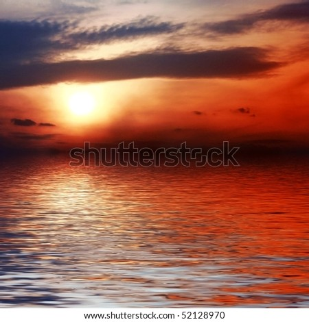 Sunset sky reflection over water. - stock photo