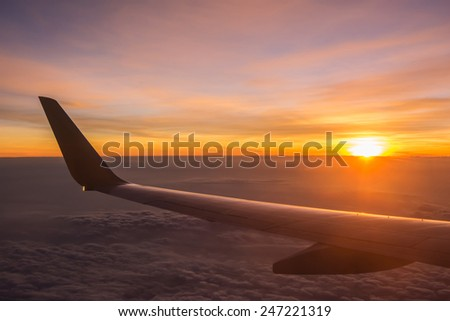 sunset sky shot from the plane on board - stock photo