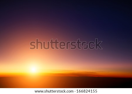 Sunset sky stratosphere background, pictured from plane. - stock photo