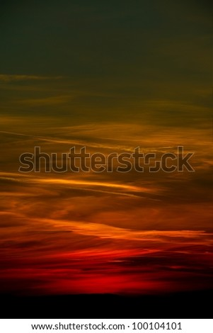 Sunset sky with dark clouds - stock photo