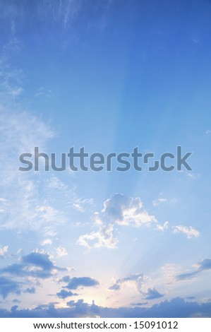 Sunset sky with sun coming through the cloud - stock photo