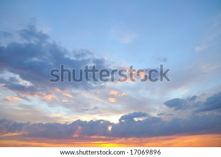 Sunset sky with sun coming through the cloud - stock photo