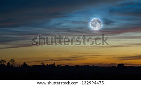 Sunset sky with the full moon - stock photo