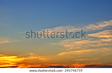Sunset sky - wonderful clouds and sunlight over blue sky - stock photo