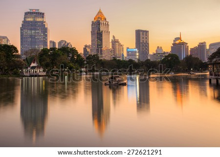Sunset skyline from Lumpini park at Bangkok, Thailand, Edit warm tone